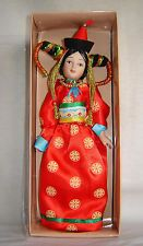 Porcelein doll in cloth national costume - Mongolia Republic