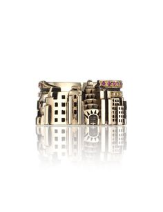 Gold New York Ring | Zara simon  Gold New York city scape ring. Encrusted with sapphires, rubies and diamonds to create the stars and stripes of the USA flag. Features the NYC sky scrapers in an interlinked band. Carved cut-out effect. 9kt gold. Wipe clean.