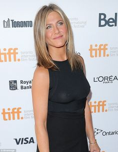 The Life Of Crime star wore a sleeveless black dress and forgot to wear a bra as she displayed her fit arms and tan gams