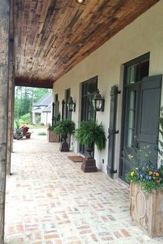 Traditional Porch with Wrap around porch, exterior brick floors Love the brick flooring Exterior House Colors, Exterior Paint, Exterior Design, Exterior Shutters, White Wash Brick Exterior, Black Shutters, Black Doors, French Door Shutters, Brick Exterior Makeover