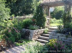 Pretty garden - sloped yard transformed into two beautiful garden areas!