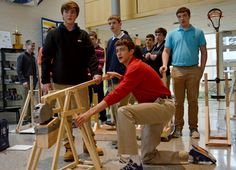 Freshmen put classroom concepts into practice this week as they designed and tested homemade trebuchets for physics class. Mr. Dunn gives in...