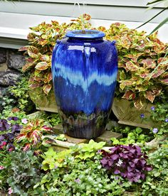 #TipTuesday Accessorize! Add colour with flowers and accessories, like this beautiful blue urn or a garden globe.