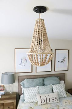 This wood bead chandelier is simple to make and costs SO much less than buying the designer version! Love this whole guest room.