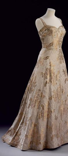 ~Evening dress by John Cavanagh. Silk brocade designed by Oliver Messel. London, 1953~      Museum no. T.294-1984