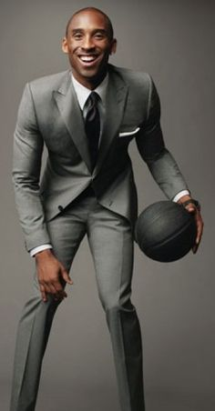 Kobe Bryant in a two button peak lapel euro style suit - Looking Sharp! The GQ Guide to Suits: Style: GQ Kobe Bryant Family, Kobe Bryant Nba, Suit Guide, Kobe Bryant Pictures, Light Grey Suits, Gray Suits, Fitted Suits, Black Suits, Moda Formal