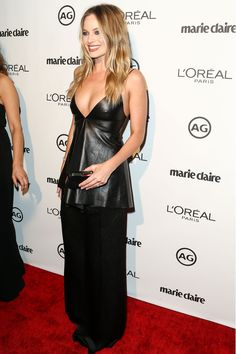 Margot Robbie wore a deep v-neck black leather peplum top with a long black under-skirt to the awards.