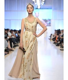 We adore the idea of this kashida-esque embroidery on a gown - Misha Lakhani