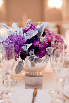grey dusty miller with purple reception wedding flowers,  wedding decor, wedding flower centerpiece, wedding flower arrangement, add pic source on comment and we will update it. www.myfloweraffair.com can create this beautiful wedding flower look.