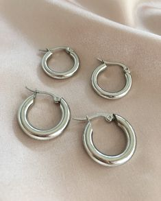 Extra chunky silver hoop earrings by The Hexad Jewelry. The ones above are 3mm thick and the ones below are 4mm thick.