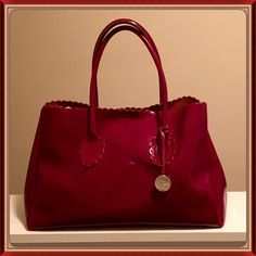 Furla handbag Apple red Furla handbag. Gently used, there's a little peeling of the clear finish on the handles and corners. Nonetheless it's in great condition. Priced accordingly. Furla Bags