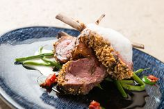 Lamb rack in hazelnut crust, ricotta cheese, green beans and garlic