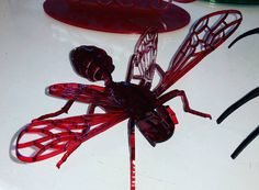 A new friend to hang out with. I'm all a-buzz with this guy. #lasercut #laserengraved #wasp #red #cutebutcreepy by zub.kitty