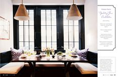 Banquet dining; ikat pillows; black French window mullions and frames