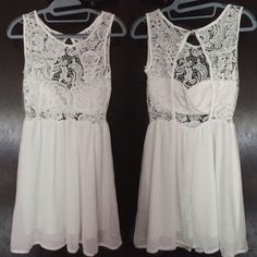 "White lace dress ➖SIZE: small (see measurements)  ➖STYLE: gorgeous white lace dress with a small open middle. The dress is lined and has padding in the bust where you don't need a bra. The open is a back connected.   MEASUREMENTS     ➖LENGTH: 32""    ➖BUST: 14.75""    ➖BACK OPENING: 13""    ➖WAIST: 12.5"" - stretchable Dresses"