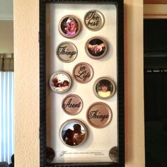 Mason jar lids spray painted with metallic paint (2 colors). Pictures cut and mod podged into threaded lids, sticker letters (glitter black), arranged in shadow box with hinged, magnetic door.