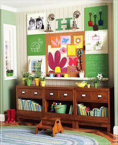 """Almost looks like three nightstands pushed together...I love this. Great display wall for projects and posters. (I couldn't handle it being this """"busy,"""" but still.)"""