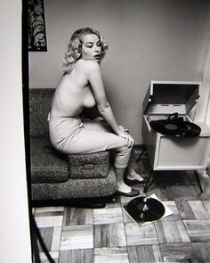 Pin -up model, American picture actress, and film producer Eve Meyer listening to records,late 50's.  Though much of her film work was in the porn intestacy, she had much artistic vision.   Sadly in 1977 Eve was killed in the Tenerife airport disaster, the histories worst aviation disaster.