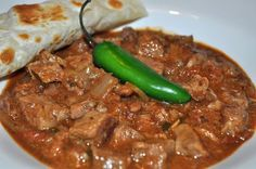 Carne Guisada - You can serve this with rice, or beans or make some great tacos! I love breakfast tacos made with some carne guisada, scrambled egg and cheese! Carne Guisada is a Mexican inspired take on beef stew. Authentic Mexican Recipes, Mexican Food Recipes, Comida Latina, Tex Mex Essen, Kitchen Boss, Comida Tex Mex, Good Food, Yummy Food, Mexican Cooking