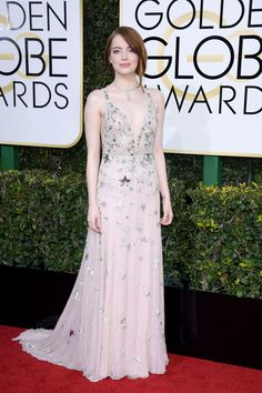 Starry Night: Emma Stone looks dazzling in a nude colored Valentino Haute Couture gown with tiny pleats, star embellishments at the 2017 Golden Globes