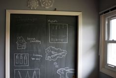 Paint closet doors with chalkboard paint.