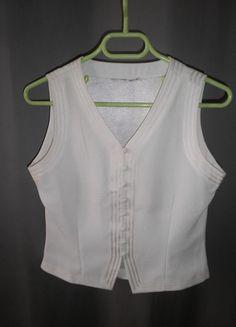 A vendre sur #vintedfrance ! http://www.vinted.fr/mode-femmes/blouses-and-chemises/19841286-gilet-en-soie-jamais-porte