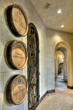 Wine barrels add such rustic charm to this wine cellar entrance! I think I need a wine cellar. Home Wine Cellars, Wine Cellar Design, Wine Tasting Room, Wine Decor, Tuscan House, In Vino Veritas, Tuscan Style, Wine Storage, Cafe Bar