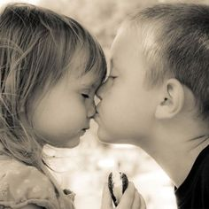 Little boy kissing little girl on the nose... and he means it.  But she wants that cupcake!  :-)
