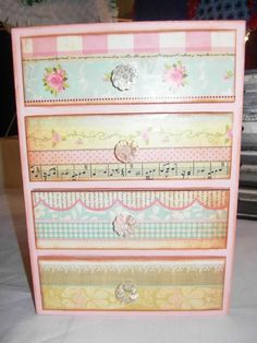 What a clever, cheap & easy way to repurpose an old dresser!  ...fancy paper, paint and glass knobs...