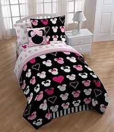 Minnie Mouse bedding for twin beds is perfect for a little girl's room, dorm room or any room that needs a little Disney magic. Decorate with a Chic black and pink Minnie Mouse comforter set or stick to Minnie's signature colors of black and red.