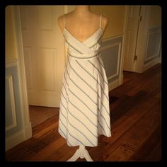 """J.Crew striped sundress 6 Gently worn J.Crew (full retail not factory) 100% cotton striped sundress.  Size 6.  Lined with 100% cotton lining as well.  Back zip.  White with navy, yellow, periwinkle & aqua stripes (see close up pic).  I'm 5'5"""" & the dress hits an inch below my knees.  Excellent condition with no issues. J. Crew Dresses Midi"""