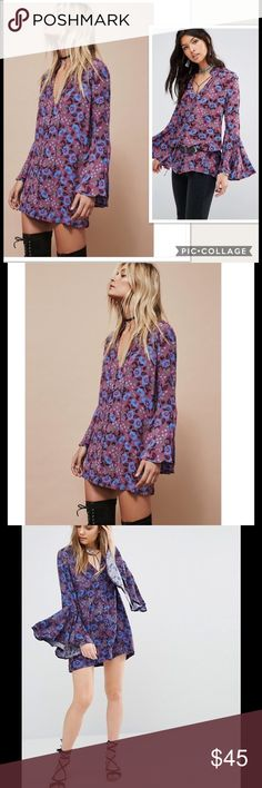 NWT Free People Magic Mystery Floral Tunic Dress Boho-chic patterns add vibrant color to a breezy tunic top styled with a gently ruffled stand collar and refined rouleau-button loops. Slim-fitting sleeves gently flare from elbow to cuff for a romantic, retro-cool look that highlights your every dance move. Front button closure. Stand collar with drawstring ties. Long bell sleeves. 100% rayon. #119 Sleeve Length: Bell Sleeves Closure: Button Front Dress Length: Above Knee, Mini Total Length…