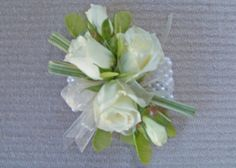 Bring out your inner Princess...floral jewelry is super hot this Prom Season! We can replicate your favorite design and match your corsage to your dress. Find us at www.flowersofcharlotte.com