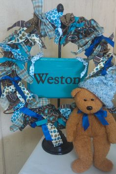 so easy baby shower wreath - tie different color ribbon onto grapevine wreath - can even add wooden sign or stuffed animal