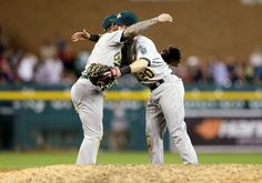 Man hug -        Oakland Athletics players Brett Lawrie, left, and Mark Canha hug after their 6-1 win over the Detroit Tigers on June 3 in Detroit.  -   © Carlos Osorio/AP