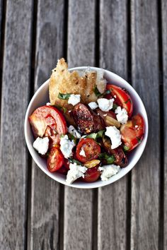 for when i start eating meat again: Jamie Oliver's chorizo and tomato salad w/ bread and goat cheese