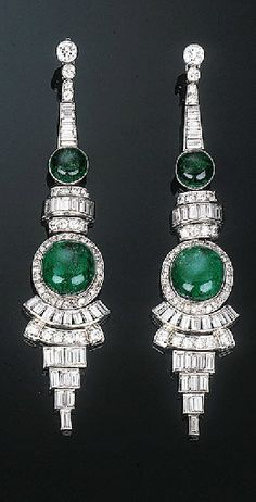 A Pair of Art Deco Emerald and Diamond Ear Pendants. Each comprising two graduated cabochon emeralds within a circular and baguette-cut diamond surround to the graduated diamond line and collet surmount, circa with French assay and maker's mark, cm long. Art Deco Jewelry, Fine Jewelry, Jewelry Design, Art Nouveau, Emerald Jewelry, Emerald Earrings, Bulgari Jewelry, Tourmaline Earrings, Jewellery Uk