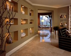 Z Tip: Have treasured items to display? Squared drywall wall niches paired with art lighting offer a unique way to present visitors with your most prized possessions. Project photo courtesy of Leslie Christian Designs http://www.lcinteriordesigns.com