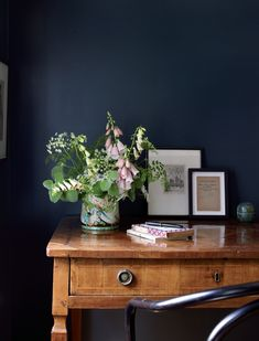 Soft florals look gorgeous against a dark wall... Possible bedroom colour?