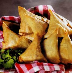 Samosas -  little pasties traditionally filled with spicy mashed potatoes.