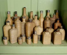 Wicker covered picnic bottles on a shelf in the Butler's sitting room at Tyntesfield -- Tyntesfield -- High quality art prints, canvases, postcards -- National Trust Prints Antique Glass Bottles, Vintage Bottles, North Somerset, Somerset England, A Shelf, Shelves, British Colonial Decor, Bamboo Canes, Jute Crafts
