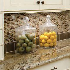 Add a little color using fruit.  Credit:  https://host24.webserveralpha.com/~rtmarket/wp/wp-content/uploads/2012/06/staging_kitchen.jpg