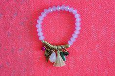 - Multi charm tassel bracelet