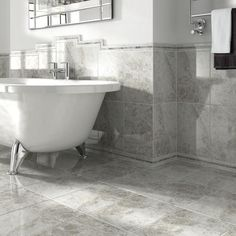 Advanced ceramic print technologies allows this Wickes cappuccino light grey gloss ceramic tile to bring a wonderfully authentic and contemporary marble finish to any home. Small Bathroom Wallpaper, Grey Bathroom Tiles, Bathroom Tile Designs, Grey Tiles, Grey Bathrooms, Modern Bathroom Design, Bathroom Interior Design, Bathroom Flooring, Bathroom Ideas