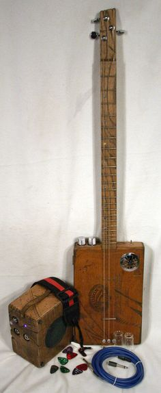 3 strings cigar box guitar and amp...  Old school Rules!
