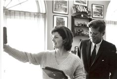 JFK & Jackie looking at pictures outside the Oval Office