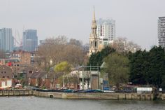 Shadwell Watersports Centre with a Hawksmoor church spire in the background.