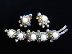 DeLizza &Elster Juliana AB Rhinestone and Faux Pearl Brooch and Earring Set Book Piece Vintage by JanesVintageJewels on Etsy https://www.etsy.com/listing/239145022/delizza-elster-juliana-ab-rhinestone-and