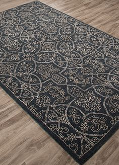 A modern take on Victorian design, this densely patterned, hand-tufted wool and…