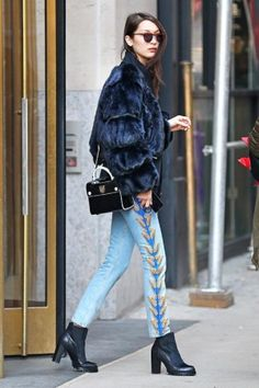Bella Hadid wearing Christian Dior Mini Diorever Bag, Gooseberry Intimates Honey Bee Bodysuit, Le Specs Mafia Moderne Sunglasses, Sol Sana Winona Boots, Sandro Beden Jeans and Hardware Ldn Onyx Fur Bomber